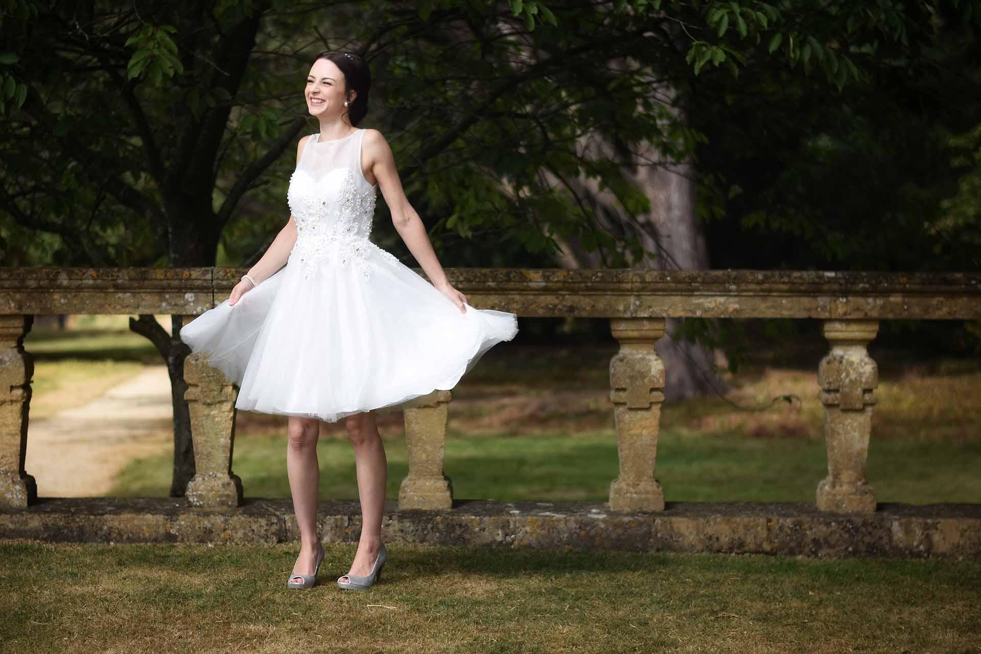 bride dancing in a garden
