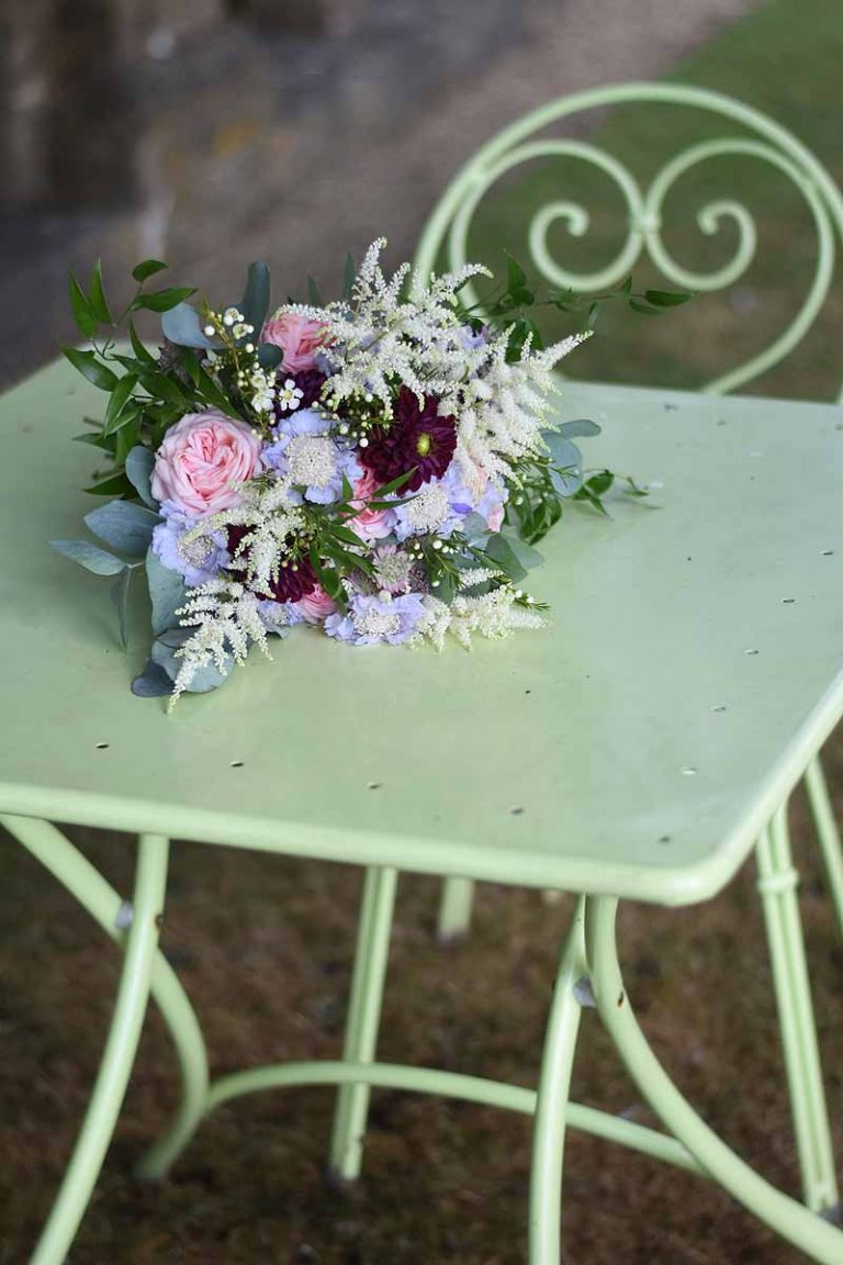bouquet resting on a pale green garden table