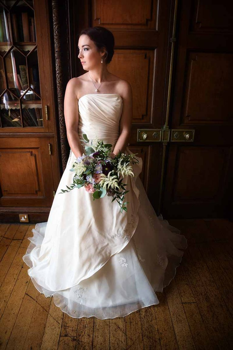 bride in ivory dress and asymmetric bouquet