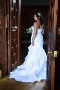 bride turning round in doorway