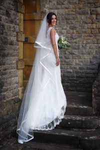 bride on steps with long flowing veil