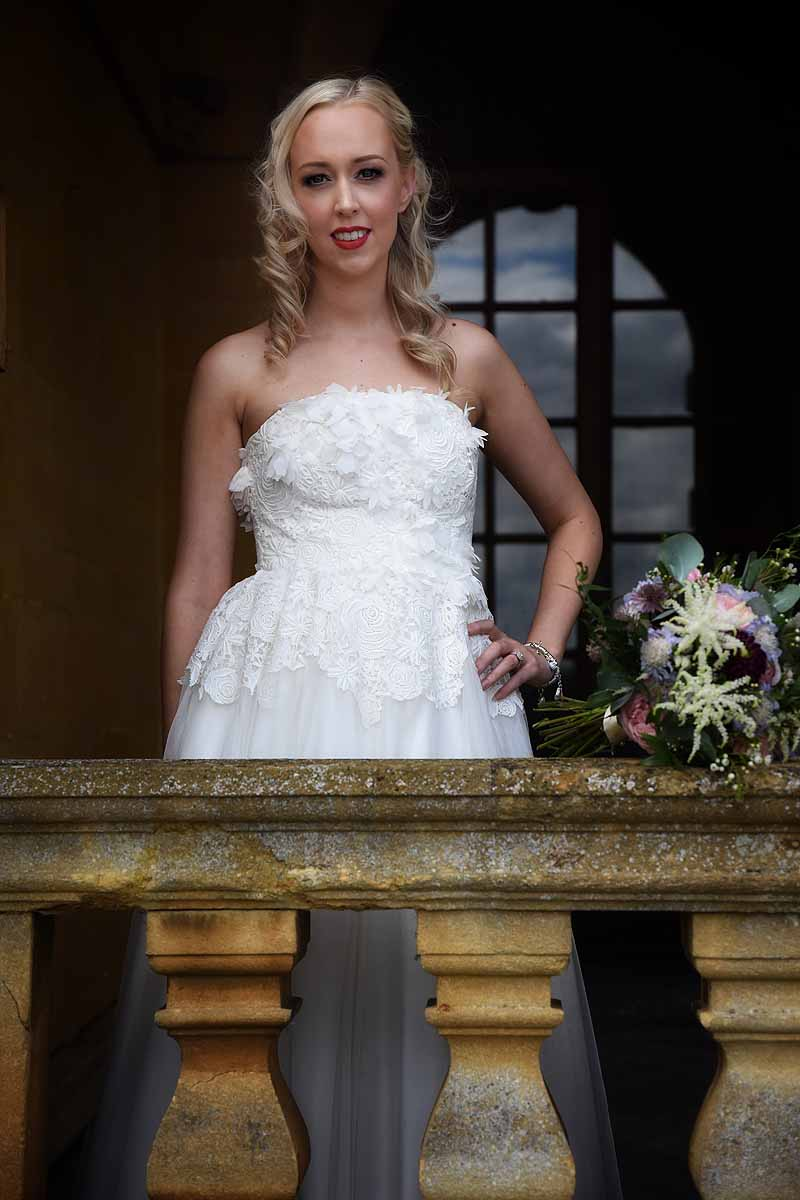 Bride standing on a balcony