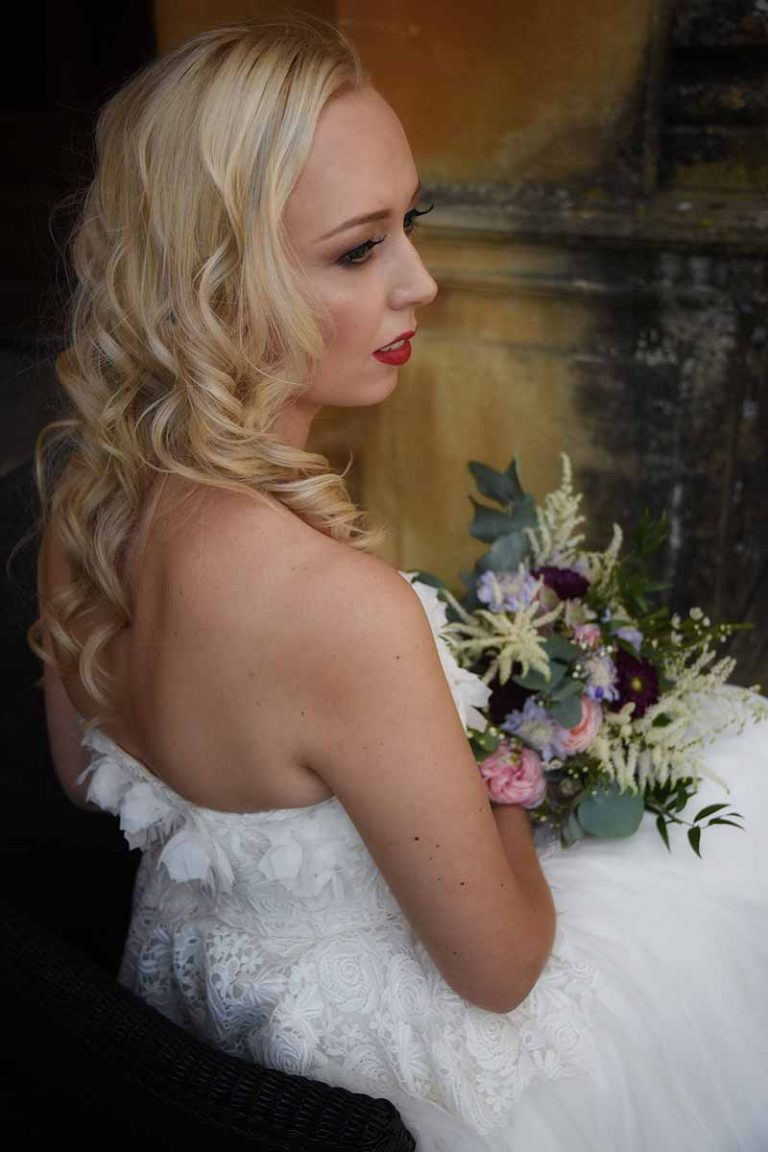 bride with curled blonde hair and red lips