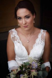 bride with lace dress and pear jewellery
