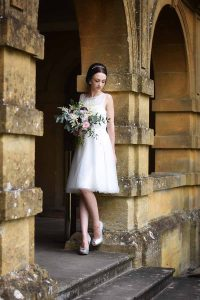 bride standing in an archway