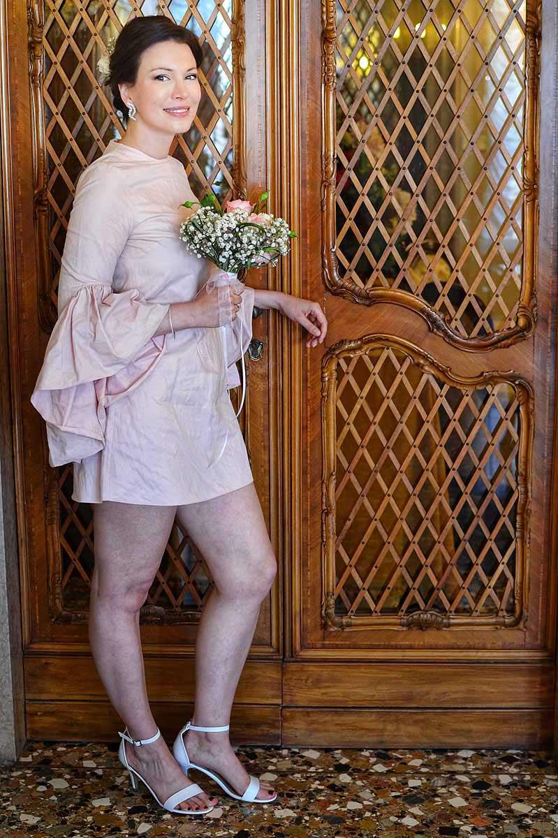 bride wearing short pink dress