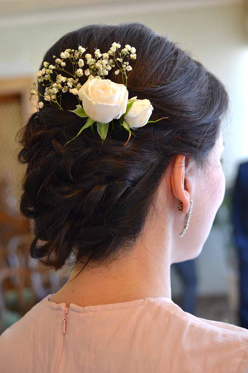 bride's hair with white rose and white gypsophila decoration