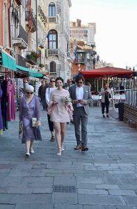 Bride, groom and mother of the bride walking in Venice