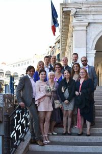Wedding guests standing on the steps of the Rialto Bridge in Venice