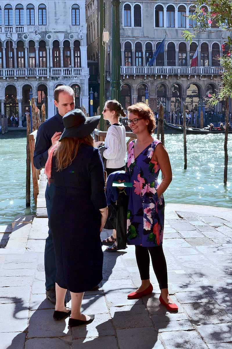 wedding guests on teh banks of the Grand Canal in venice