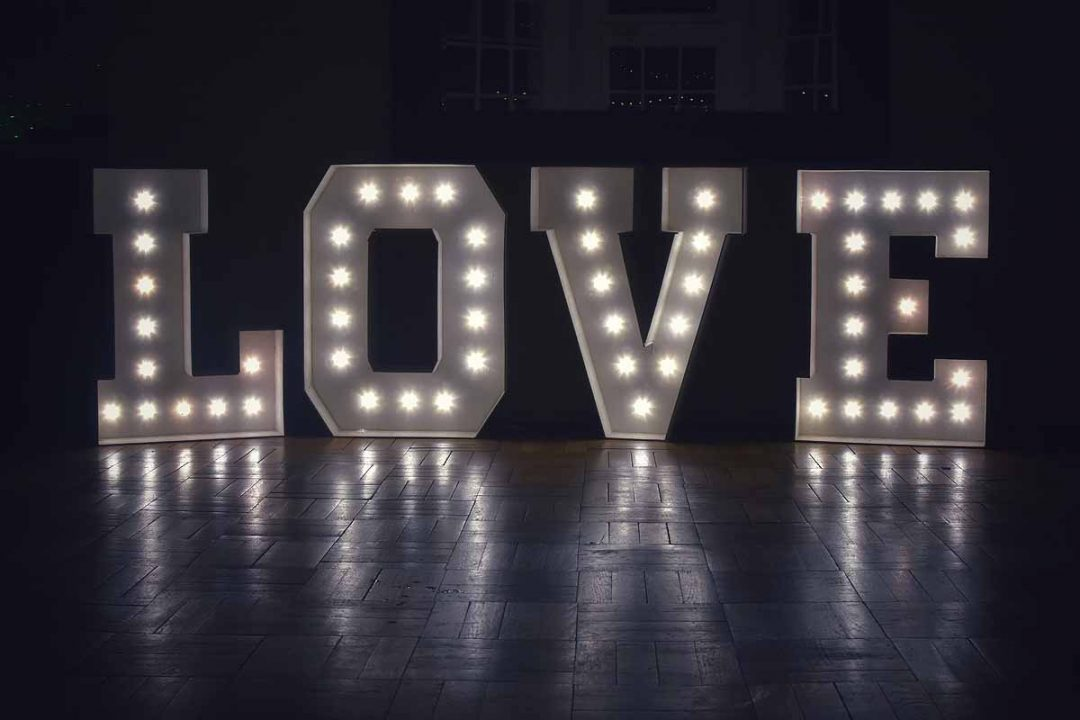 Neon love letters on the dance floor at Gildredge Manor, Eastbourne