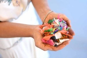 hands holding colourful confetti
