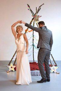 bride twirling under groom's arm