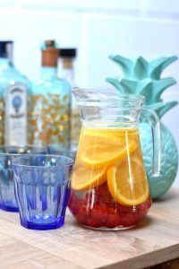 jug of fruit punch and glasses