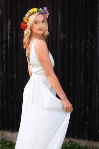 Blonde bride wearing a rainbow flower crown