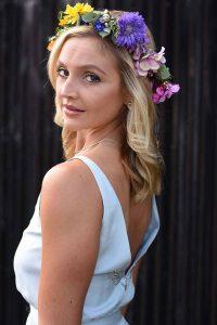 Bride with flower crown looking back over her shoulder
