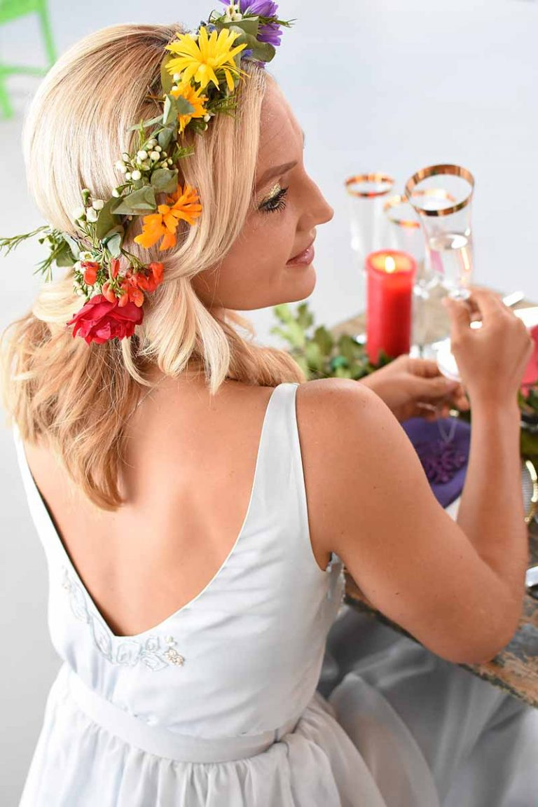 bride wearing a rainbow flower crown