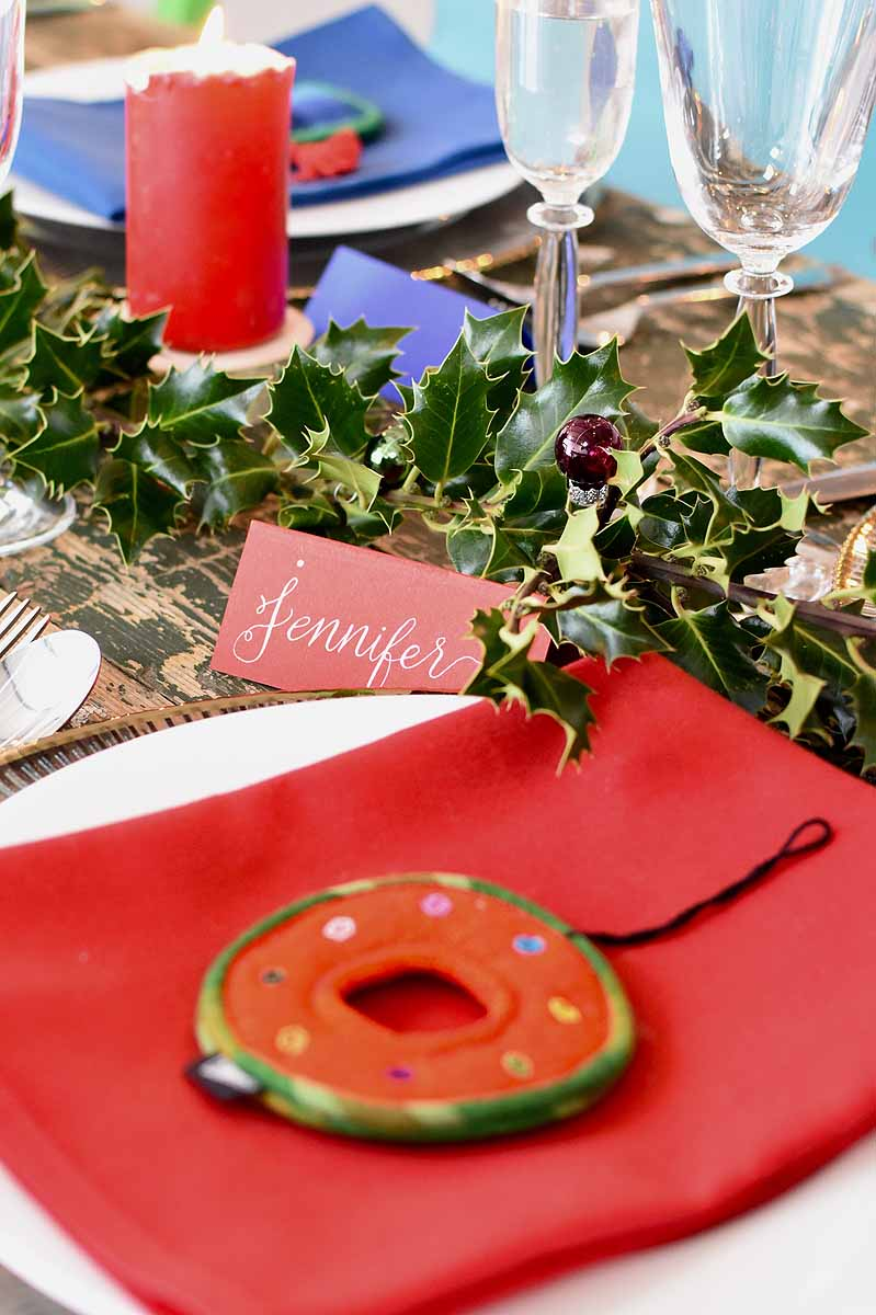 table details with holly and silver calligraphy