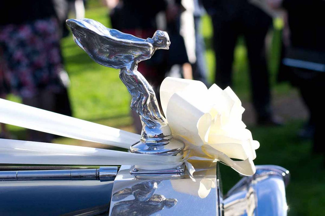 Spirit of ecstasy on Rolls Royce wedding car