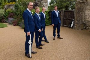 ushers with umbrellas in Caswell House garden