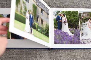 bride and groom photos inside a wedding album