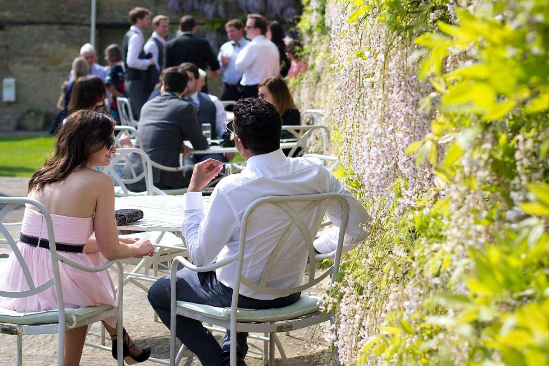 Wedding guests at a wedding reception, The Great Barn, Aynho, Oxfordshire