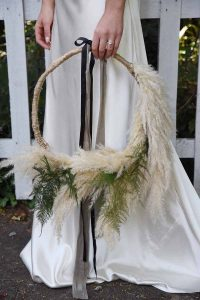hoop flower arrangement with pampas grass and asparagus fern