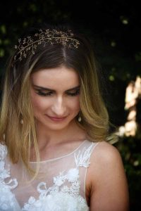 Bride with blonde hair with a gold and crystal hair vine