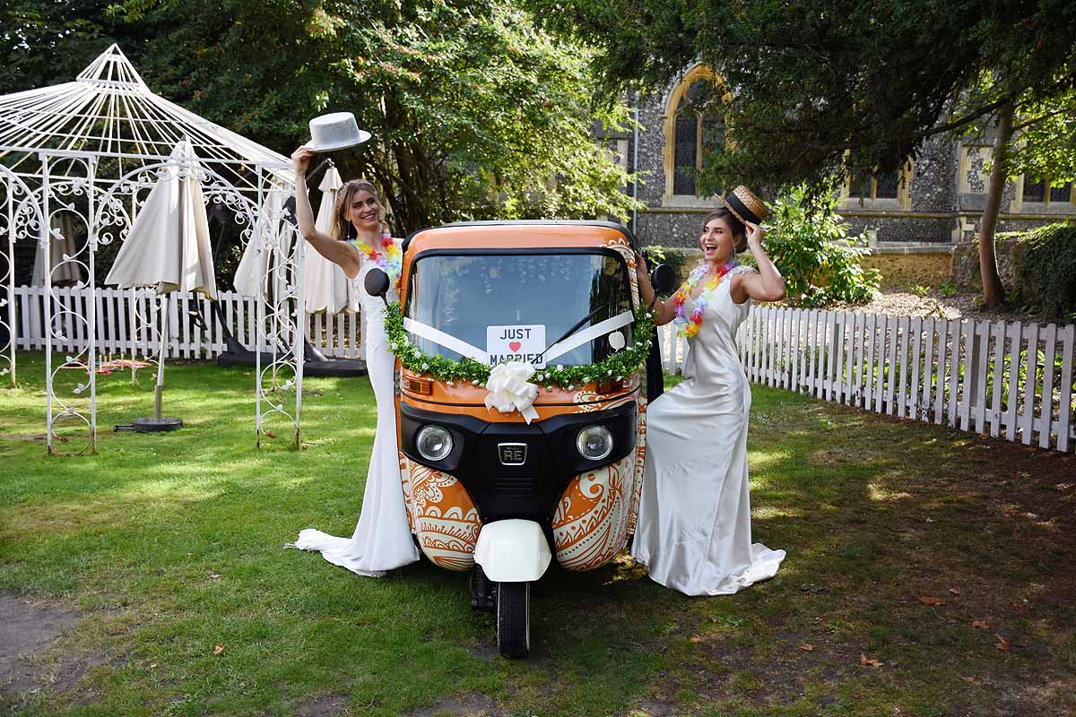 Two brides with a tuk tuk photobooth