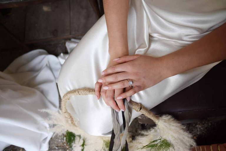 Bride wearing an engagement ring by MacAngus Designs