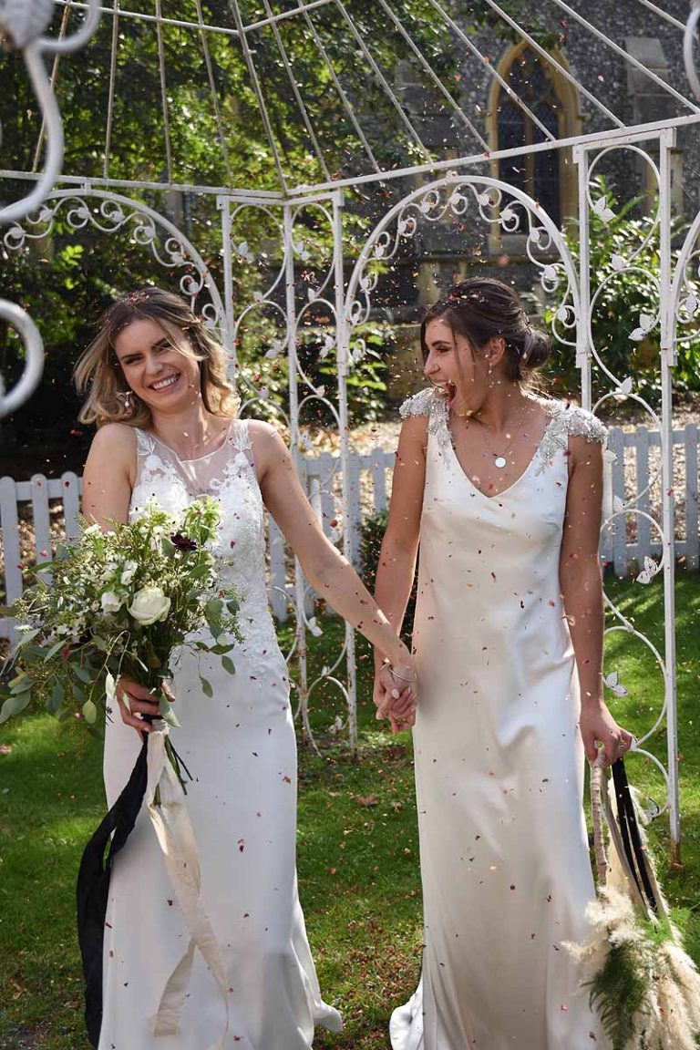 brides being showered with confetti in the garden at the Elephant Hotel in Pangbourne