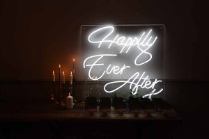 Happily Ever After neon sign and candles