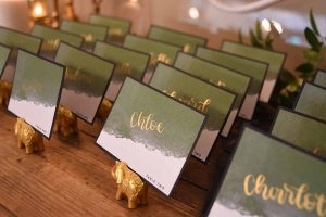 White green and gold place settings by Cosmic Calligraphy