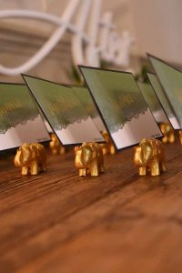 Gold elephant table name card holders with cards