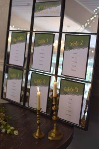 green and gold table name cards