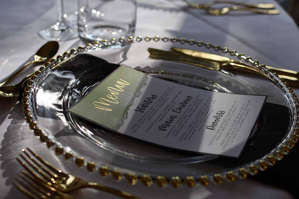 Wedding breakfast menu in green, gold, black and white