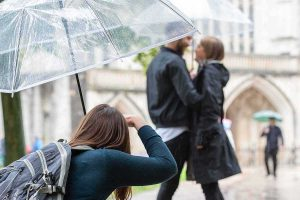 taking a photograph under an umbrella
