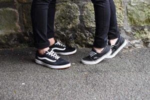 his and her black and white trainers