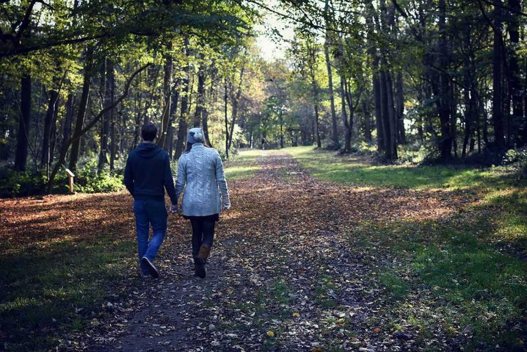 couple walking in Wytham Woods in Autumn