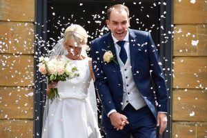 Confetti throw over bride and groom