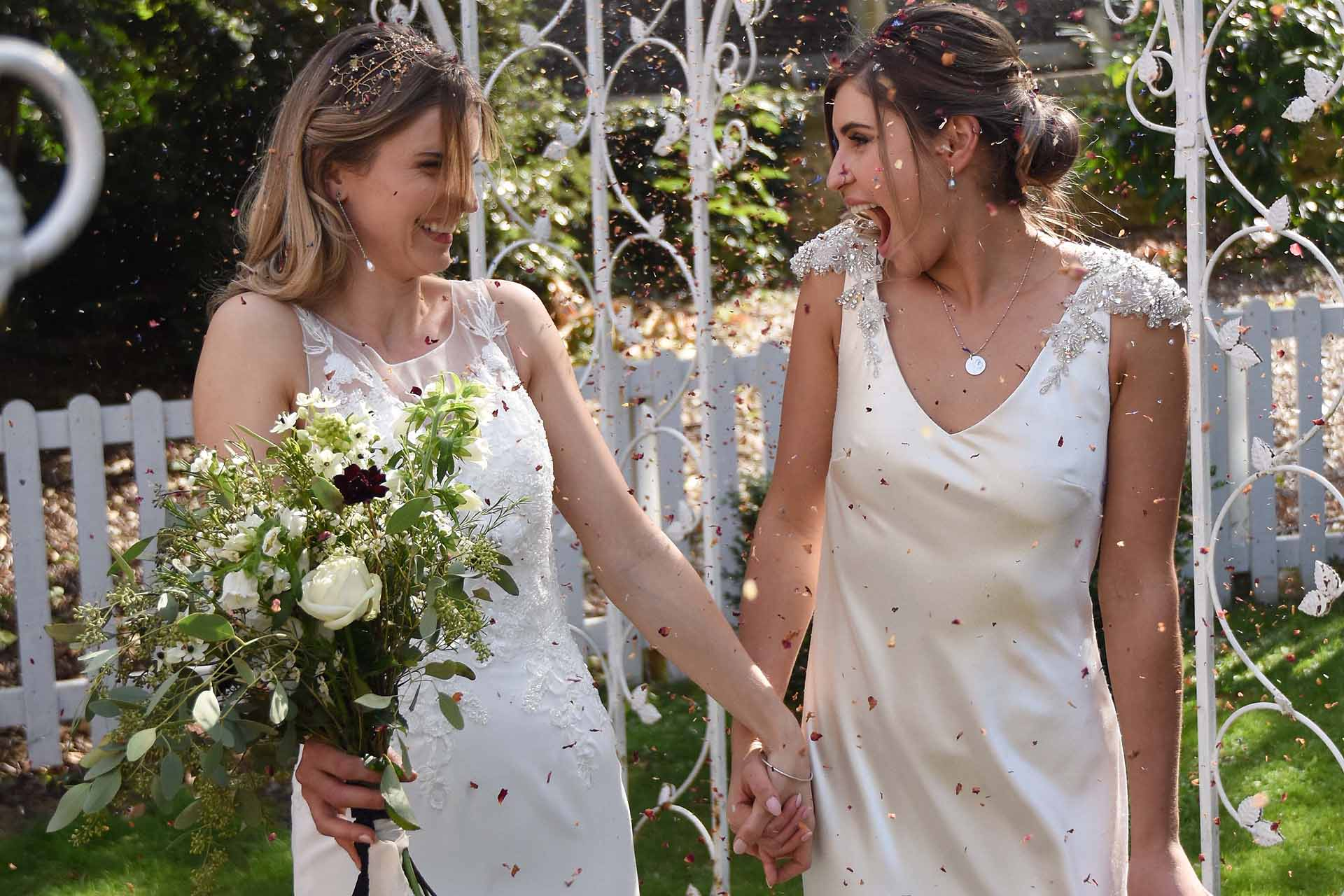 Brides in a confetti throw