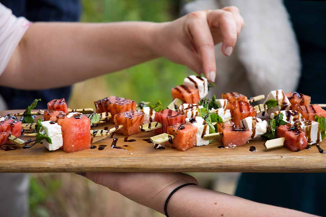 Watermelon, feta and mint skewers drizzled with balsamic vinegar