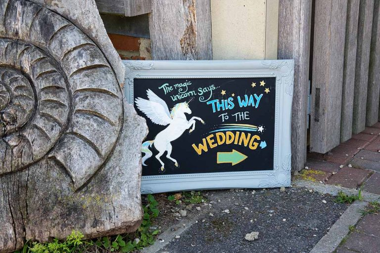 This way to the wedding unicorn sign