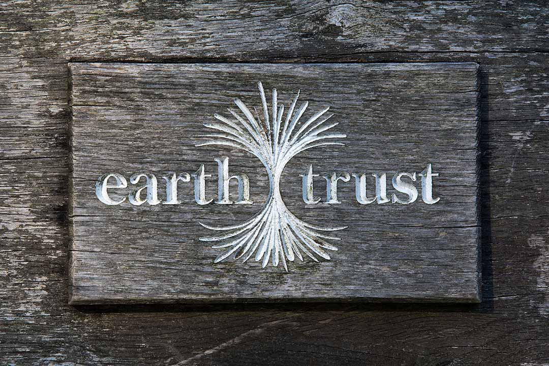 The Earth Trust wooden sign