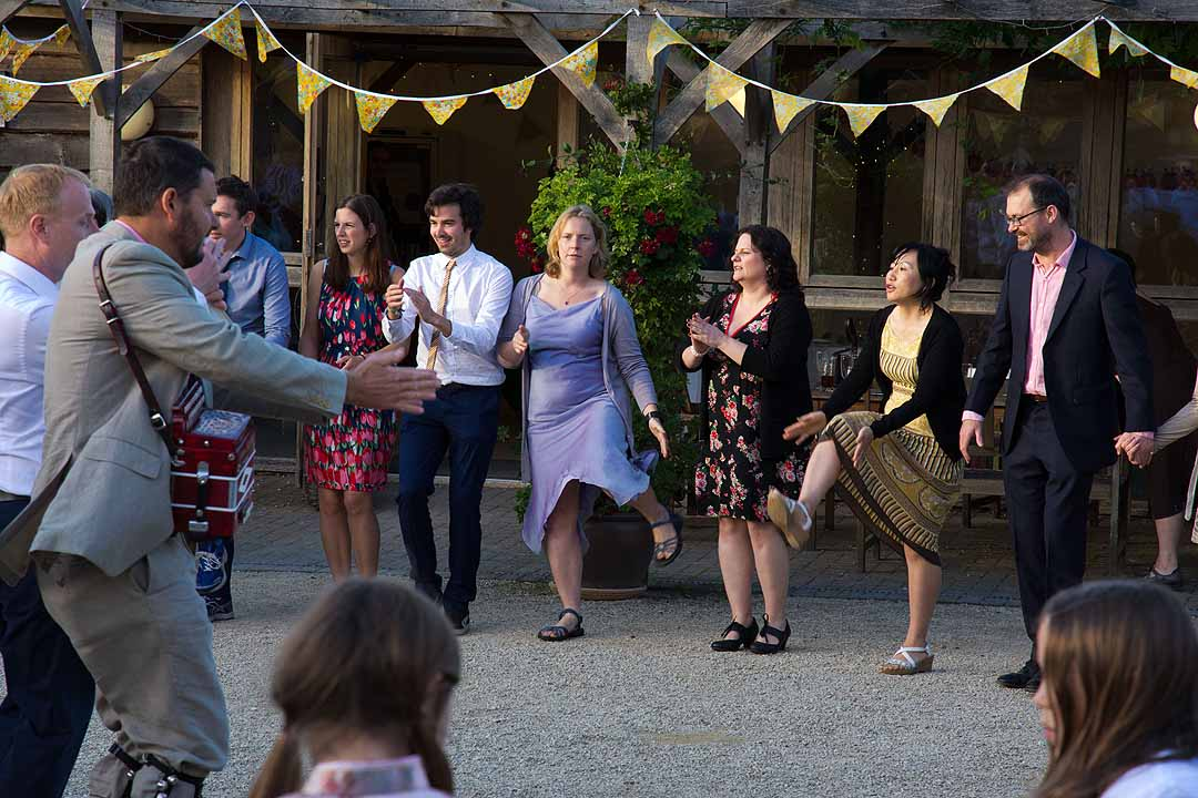 Wedding guests dancing at the Fison Barn, Oxfordshire
