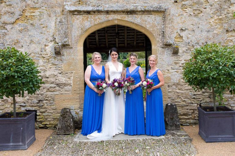 Bride with bridesmaids in blue dresses