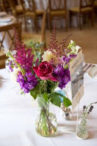 pink and purple flowers on a table