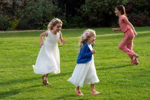 girls running in the garden
