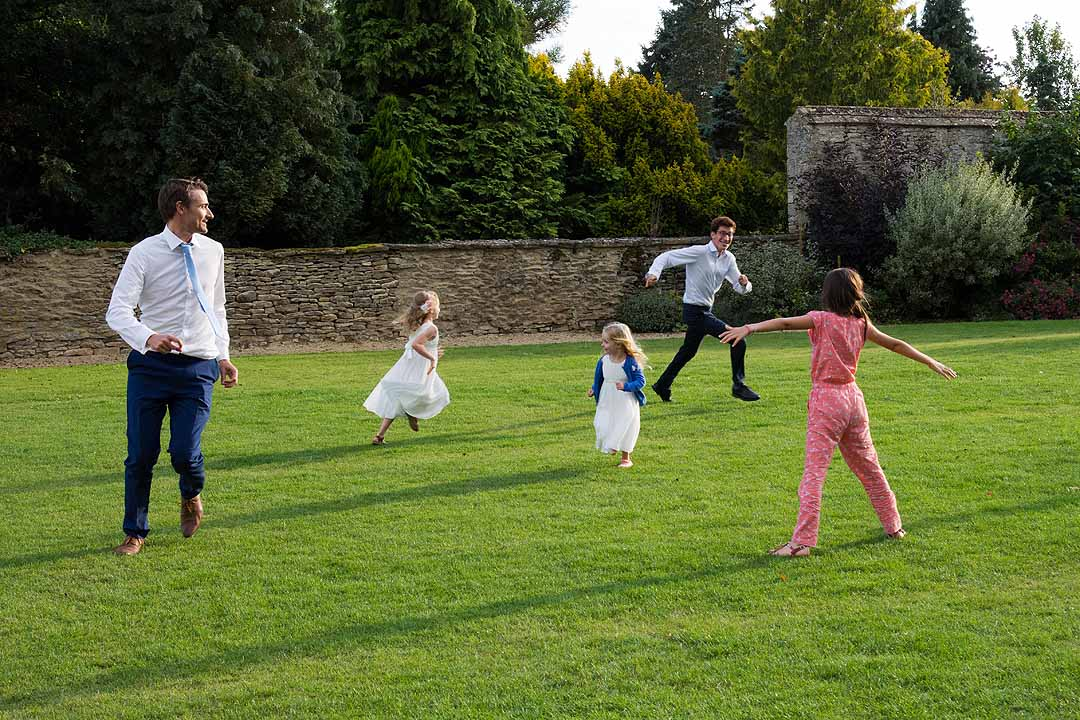 people running and playing in the grounds at Caswell House, Cotswolds
