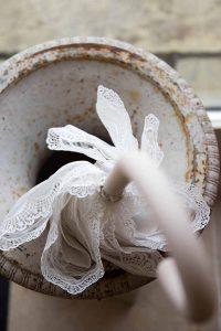 white lace umbrella in a round stone pot